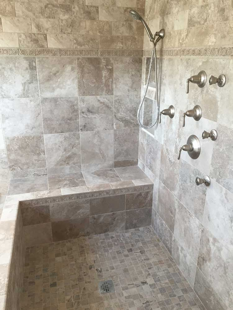 tiled walk in shower with wrap around bench using fiberglass shower pan